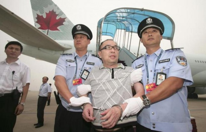 Chinese fugitive Lai Changxing is escorted back to Beijing from Canada, at Beijing International Airport, July 23, 2011.