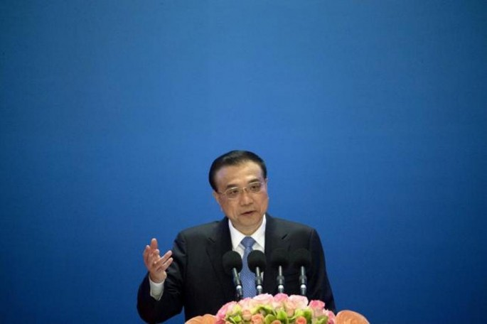 Chinese Premier Li Keqiang speaks during the Inaugural Meeting of the Board of Governors of the Asian Infrastructure Investment Bank (AIIB) in Beijing, China, Jan. 16, 2016.