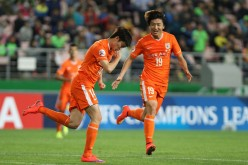 Shandong Luneng players celebrate a goal during one of their 2015 AFC Champions League matches.