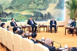 Chinese President Xi Jinping (center) urged non-Communist Party of China parties to contribute more valuable advice for the country's development.