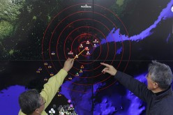 Scientists from the Korea Meteorological Administration point at the screen showing seismic waves near Seoul, South Korea, caused by a North Korean hydrogen bomb test on Jan. 6, 2016.