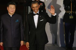 Chinese President Xi Jinping and U.S. President Barack Obama pose for photographers on the North Portico ahead of a state dinner at the White House, Sept. 25, 2015.