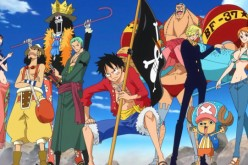 Luffy, together with his crew, is holding his Jolly Roger.