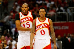 Atlanta Hawks' Al Horford (L) and Jeff Teague.