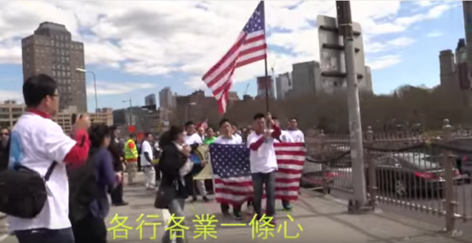 Members of the Chinese-American community join a rally to show support for Peter Liang in March last year.
