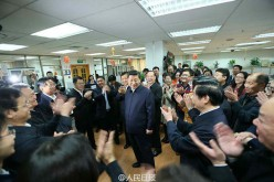 President Xi Jinping meets with the editors and other staff in the newsroom at the headquarters of People's Daily newspaper.