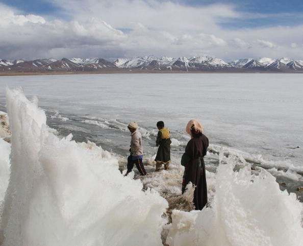 Tibetan Children Play On Frozen Namtso Lake