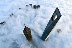 Tops of landmark skyscrapers, including the Oriental Pearl Tower, are seen over cloud sea in Shanghai, east China, Feb. 12, 2016.