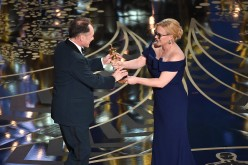 Mark Rylance accepts the Best Supporting Actor award for 'Bridge of Spies' from Patricia Arquette onstage during the 88th Annual Academy Awards at the Dolby Theatre in Hollywood, California.