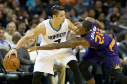 Jeremy Lin is defended by Archie Goodwin of the Phoenix Suns.