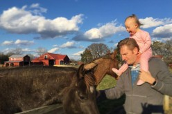 Seen here are Rory Feek along with his toddler daughter. Rory founded a duo with his wife Rory Feek called Joey+Rory and released several hits including