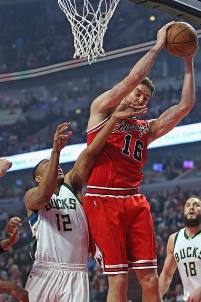 Pau Gasol #16 of the Chicago Bulls rebounds over Jabari Parker #12 of the Milwaukee Bucks at the United Center on March 7, 2016 in Chicago, Illinois.