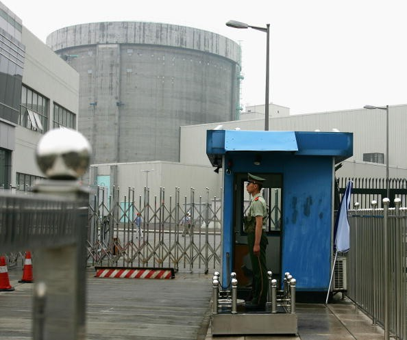 A policeman guards the entrance of a nuclear power plant in Qinshan of Hangzhou City, Zhejiang Province, China, on June 10, 2005.