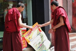 Monks Hold A Poster Promoting The Prevention Of AIDS