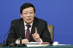 Finance Minister Lou Jiwei is unfazed by downgraded rating on China's economy.