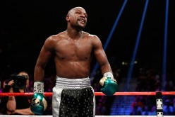 Floyd Mayweather Jr. walks in the ring during his WBC/WBA welterweight title fight against Andre Berto.