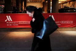 A woman walks by a Marriott hotel in midtown Manhattan in New York City on March 21, 2016.