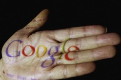 The logo of the multi-facetted internet giant Google is seen projected onto the palm of a hand.