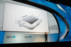 Satoru Iwata, Global President, Nintendo Co., Ltd., speaks during a news conference after the unveiling of the new game console Wii U at the Electronic Entertainment Expo.