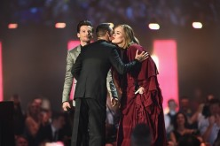 Adele receives her Best British Female Solo Artist award on stage from presenters Liam Payne and Louis Tomlinson at the BRIT Awards 2016 in London, England.