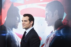 Henry Cavill posing during the red carpet premiere of