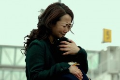 "Mountains may depart but never a mother's love: Zhao Tao, who lost a custody battle, embraces her son who will live with his father in Australia in Jia Zhangke's 2015 drama, ""Mountains May Depart."""
