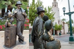 """Storytellers,"" the statue of Walter Elias ""Walt"" Disney, the co-founder of The Walt Disney Company, together with the iconic character Mickey Mouse, stands at Disney California Adventure."