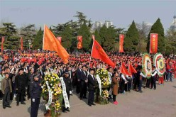 People attend a commemoration ceremony at a martyr cemetery in Jinan, capital of east China's Shandong Province, April 1, 2016.