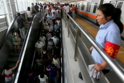 A subway staff member keeps watch at the Zhichunlu Station on the Subway Line 10 in Beijing, China, July 21, 2008.