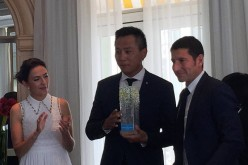 Merci! Liu Ye is flanked by his French wife Anais Martane and David Lisnard, mayor of Cannes, during his appointment as travel ambassador for the French Riviera.