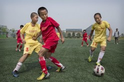 China is investing in young soccer players for a bigger goal.