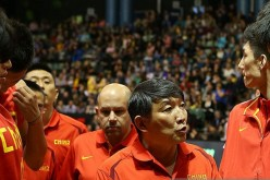 China men's national basketball team head coach Gong Luming (middle).