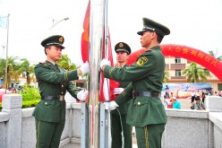 Soldiers raise the Chinese national flag in Sansha City in Xisha Islands.