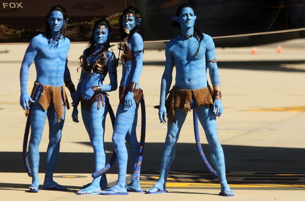 Models dressed up as characters from the film 'Avatar' pose during the launch of 'Avatar' Blu-ray and DVD at Sydney Domestic Airport on April 29, 2010 in Sydney, Australia.