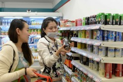 People shop at Xuzhen Supermarket on April 13, 2016 in Shanghai, China. All goods in the supermarket are empty, but the price is the same as usual.