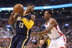 DeMar DeRozan defends Paul George during game 1 of the Toronto Raptors vs. Indiana Pacers first round playoff match-up.