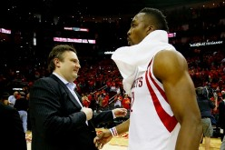 Daryl Morey congratulates Dwight Howard after coming out with a victory against the Utah Jazz.