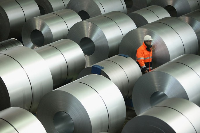 China has laid off hundreds of workers and closed several companies due to overcapacity in the steel industry.