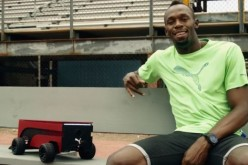 Usain Bolt is seen with the Puma BeatBot
