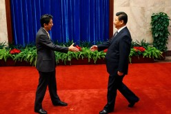 Japanese President Shinzo Abe meeting with President Xi Jinping. Sino-Japanese ties improve as China welcomes the first Japanese dignitary in four years.