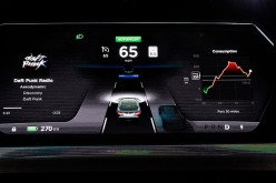 The dashboard of Tesla 'D' model electric sedan is seen on a giant screen in 2014.