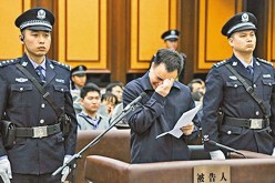 The former Communist Party Chief of Guangzhou, Wan Qinliang cries during his trial in this undated file photo.