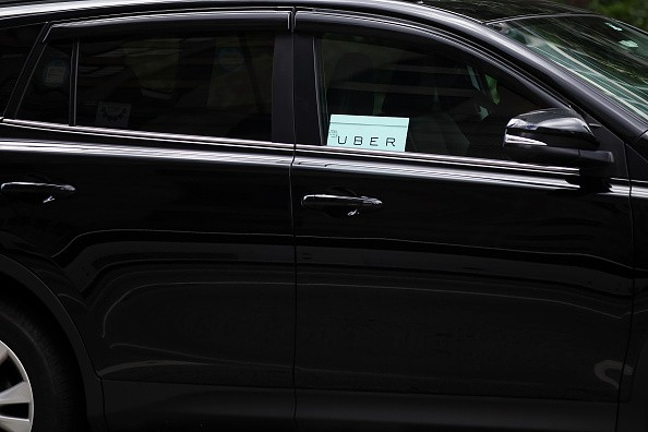 An Uber vehicle is seen in Manhattan on July 20, 2015 in New York City.